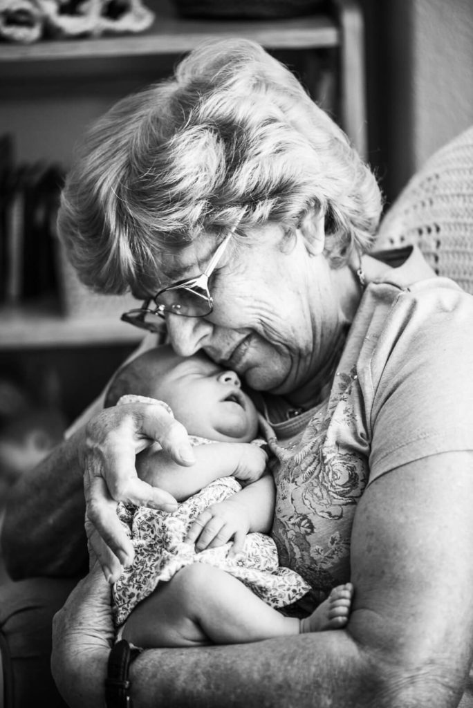 grandma holds baby girl close to her chest