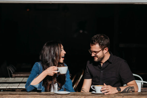 man and woman chat over coffee