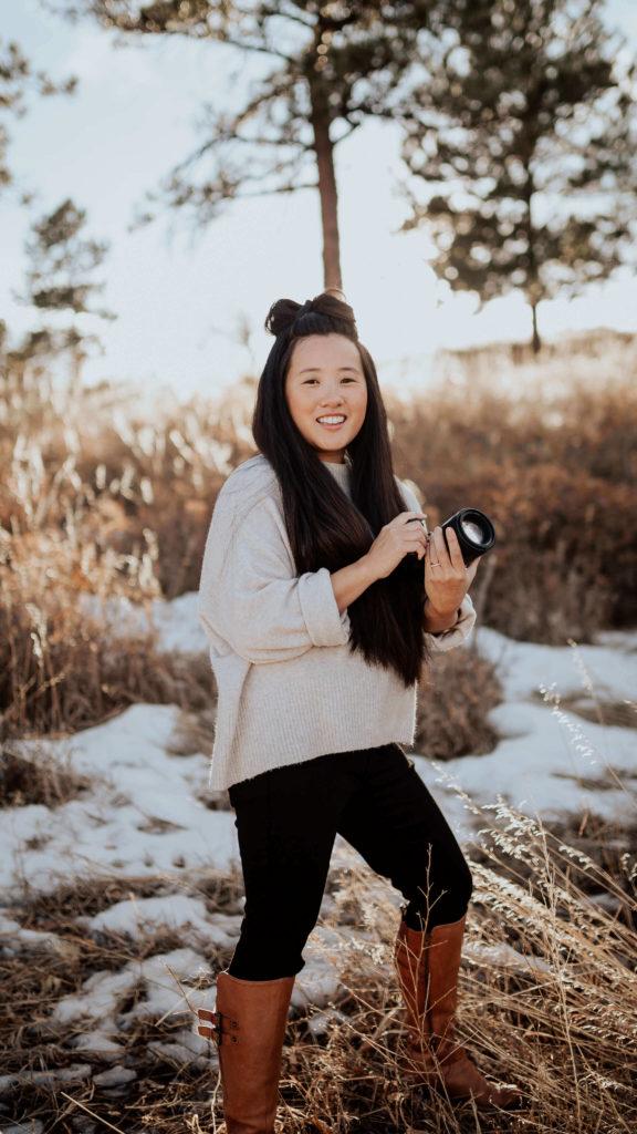 taryn kimberly holding camera headshot