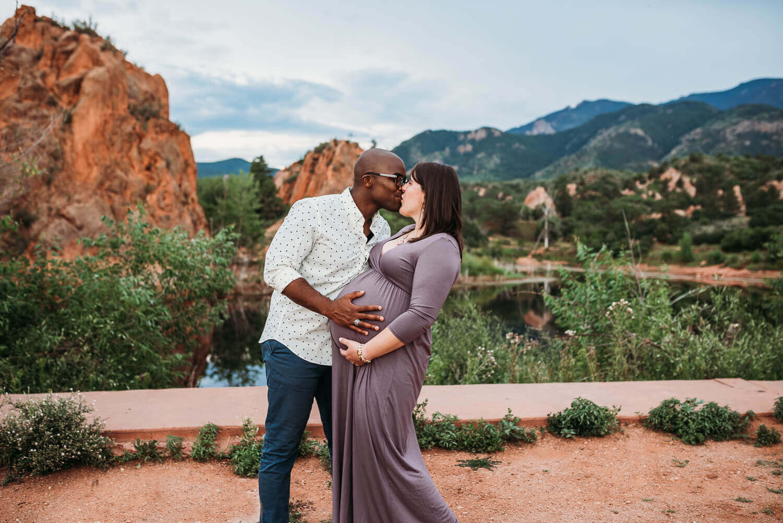 husband kisses pregnant wife